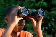 Boy Watching Birds with Binoculars