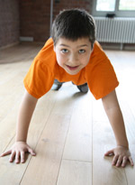 Boy in Orange Shirt Doing Pushups