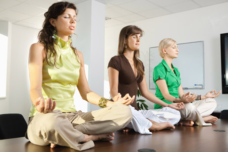 Business Women Meditate on a Conference Table
