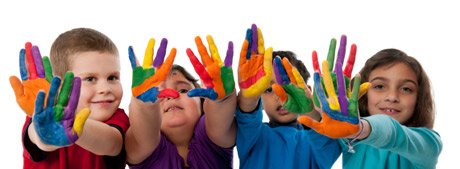 row of kids with painted rainbow hands