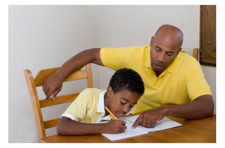 Father Tutoring Son on Math Homework