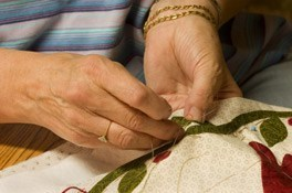 Senior Hands Embroider a Rose