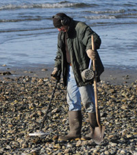 Man Beachcombing with Metal Detector in Seattle