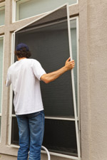 Man Installing energy Efficient Window