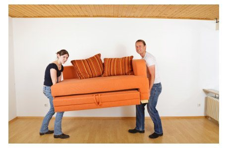 Couple Moves Orange Couch into Home