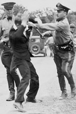Police Remove Striker from 1935 Timber Strike