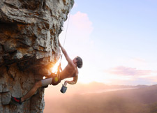 Rock Climber on Cliff Face