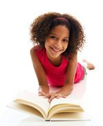 Smiling Tween Girl reading Book