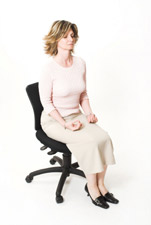 Woman Meditates in her Office Chair